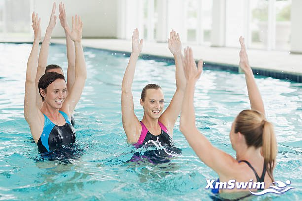 women-taking-water-aerobics-class-in-swimming-pool-picture-id147205578.jpg